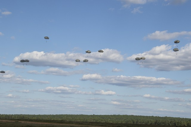 XVIII Airborne Corps paratroopers descend from the sky during an airborne operation at Fort Bragg, N.C, Sept. 18, 2019. The Soldiers completed the jump days after arriving home from their deployment to the Middle East as the Combined Joint Task Force Operation Inherent Resolve headquarters. (U.S. Army photo by Pfc. Daniel J. Alkana/22nd Mobile Public Affairs Detachment)