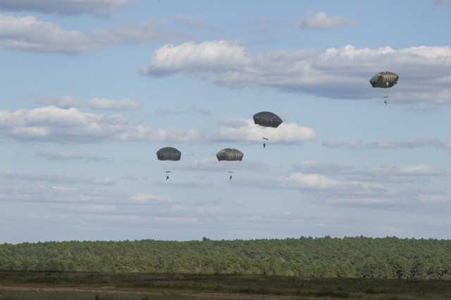 Soldiers with the XVIII Airborne Corps jump from a C-130H Hercules September 18, 2019, at Sicily Drop Zone, Fort Bragg, N.C. The Soldiers completed the operation to maintain jump status qualification after a more than year-long overseas deployment. (U.S. Army photo by Pfc. Daniel J. Alkana/22nd Mobile Public Affairs Detachment)
