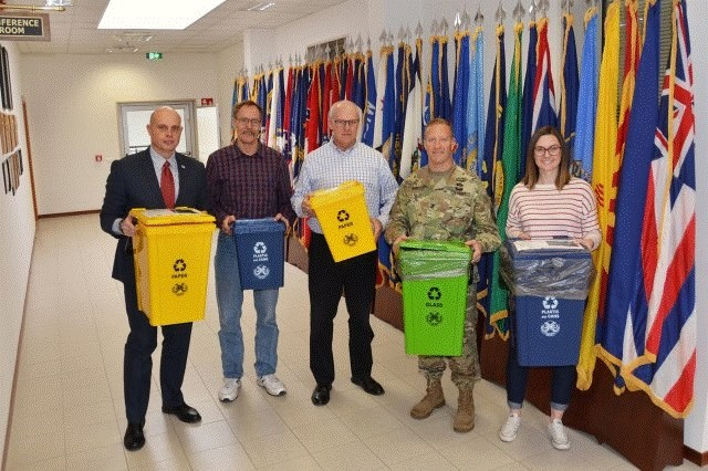 Showing off the new containers are, from left: Frank Lands, deputy to the garrison commander; Kurt Brownell, solid waste/recycling compliance manager; Bob Laramore, chief, Environmental Division; Col. Erik M. Berdy, commander, U.S. Army Garrison Italy; and Jennessa Peterson, environmental specialist.