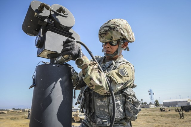 Army Reserve Sgt. Griselda Cazales, a chemical operations specialist and native of Ontario, California, assigned to the 307th Chemical Company, 453rd Chemical Battalion, 209th Regional Support Group, 76th Operational Response Command, attaches a cable to sensing equipment on top of a Humvee equipped with a Biological Integrated Detection System (BIDS) during unit chemical detection operations at Los Alamitos, Calif. Sept. 13.  The training was part of a brigade wide Field Training Exercise that involved more than 2000 Army Reserve Soldiers, four battalions and 15 companies conducting a variety of training simultaneously at locations across the nation as part of an ambitious brigade level field training exercise (FTX) hosted by the 209th Regional Support Group, 76th Operational Response Command.