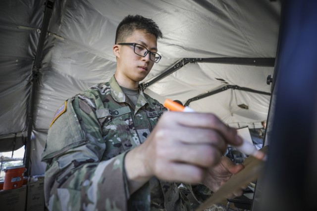 Army Reserve Spc. Simon Cho, a wheeled-vehicle mechanic and native of Downey, California, assigned to the 307th Chemical Company, 209th Regional Support Group, 76th Operational Response Command, prepares an information board at a Tactical Operations Center in Los Alamitos, Calif., Sept. 13, during a four-day brigade wide Field Training Exercise.  The exercise involved more than 2000 Army Reserve Soldiers, four battalions and 15 companies conducting a variety of training simultaneously at locations across the nation as part of an ambitious brigade level field training exercise (FTX) hosted by the 209th Regional Support Group, 76th Operational Response Command.