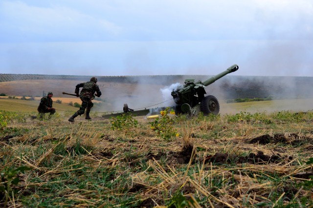 Moldovan Soldiers complete an artillery mission during Operation Fire Shield 2019 hosted by Moldova, Sept. 17 at Bulboaca Training Area, Moldova. Fire Shield's mission is sharing knowledge and best practices between the NCNG and ALNG artillery experts Moldovan Soldiers and officers and other nations attending the annual event. The NCNG has teamed with Moldova for more than two decades via the State Partnership Program designed to increase peace and stability across Europe.