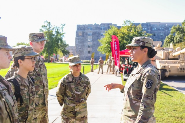 1st L. Leah Phillips talks to cadets from the Fordham University ROTC program about opportunities with the Field Artillery branch during Branch Week at the U.S. Military Academy. ROTC programs from throughout the region had the chance to learn about all 17 Army branches while touring the branches' displays at West Point.