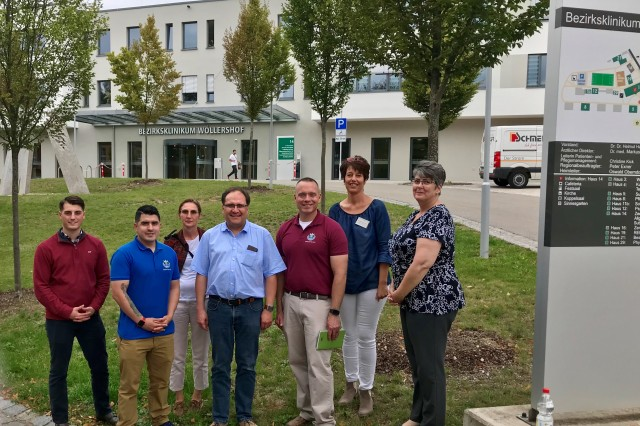 Members from the U.S. Army Health Clinic Grafenwoehr recently visited the Integrierte Leitstelle (ILS) Nordoberpfalz and Medbo Bezirksklinikum Woellershof as part of their host nation key leader engagement, Sept. 16, 2019. Clinic staff visits and key leader engagements help strengthen and expand the partnership between the military treatment facilities and host nation medical facilities while also ensuring military readiness.From left to right: Spc. John Bentz, Medic; Sgt. 1st Class Joey Rivera, USAHC Grafenwoehr detachment sergeant; Erika Walberer-Reis, TRICARE benefits counselor; Dr. Markus Wittmann, medical director and psychiatrist; Lt. Col. Avery Carney, USAHC Grafenwoehr commander; Christine Kick, quality management and nursing director of psychiatry; and Tammy Sue Cook, nurse case manager.
