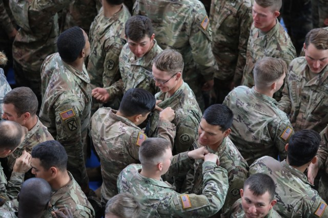 U.S. Army Soldiers assigned to the 2d Cavalry Regiment are pinned their air assault badge after successfully graduating from the ten day course during a ceremony at the Tower Barracks Fitness Center in Grafenwoehr, Germany, Sept. 20, 2019. More than 180 Soldiers graduated the mobile training team led course. (U.S. Army photo by Capt. Ellen C. Brabo, 2d Cavalry Regiment)