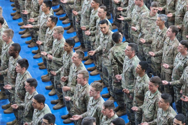 More than 180 U.S. Army Soldiers from across U.S. Army Europe wait to have their air assault wings pinned during a graduation ceremony at the Tower Barracks Fitness Center in Grafenwoehr, Germany, Sept. 20, 2019. The ten day course is hosted by a mobile training team each year. (U.S. Army photo by Capt. Ellen C. Brabo, 2d Cavalry Regiment)