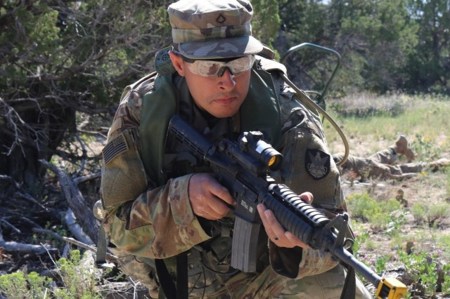 Pfc. Jose Garcia, Headquarters and Headquarters Company, 1st Space Battalion, 1st Space Brigade, scans his sector of fire during a react to contact lane as part of field training exercise August 28, 2019 at Fort Carson, Colo. The field training exercise was designed to reinforce basic warrior tasks and Soldier skills. (U.S. Army Photo by 1st Sgt. Steve Segin)