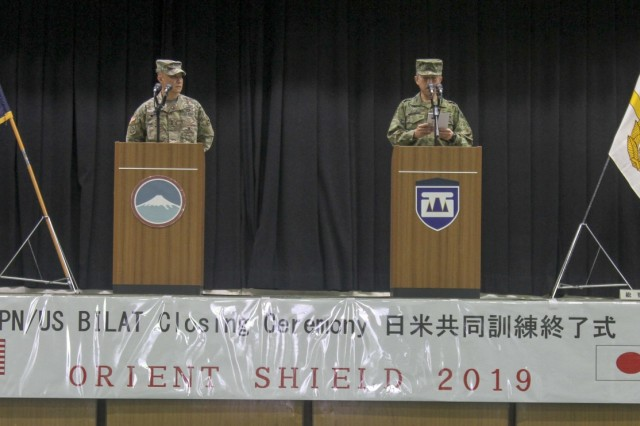 U.S. Army Maj. Gen. Viet X. Luong, commander, U.S. Army Japan, and Japan Ground Self-Defense Force Lt. Gen. Takashi Motamatsu, commander, JGSDF Western Army, host the closing ceremony for Orient Shield 2019 Sept. 24, 2019, Camp Kengun, Japan. During the ceremony both generals highlighted how the exercise underscores a continued commitment by the United States and Japan to work as dedicated partners in support of the Japan-U.S. security alliance and for peace and stability in the Indo-Pacific region. OS 19 is a premier U.S. Army and Japan Ground Self-Defense Force bilateral field training exercise that is meant to increase interoperability by testing and refining multi-domain and cross-domain concepts. (U.S. Army photo by Staff Sgt David Edge, 20th Public Affairs Detachment)