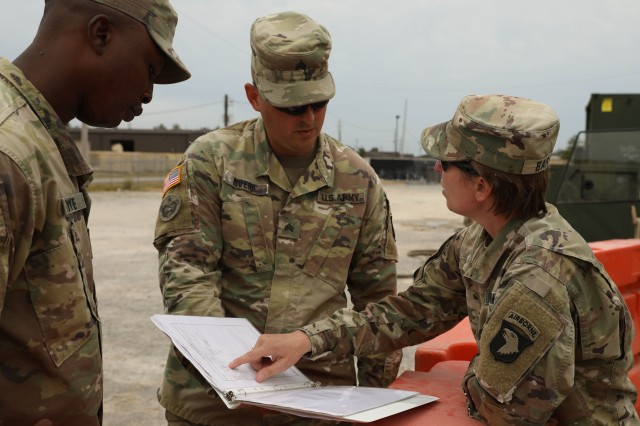Col. Stephanie Barton (right), commander, 101st Sustainment Brigade, 101st Airborne Division (Air Assault), reviews distribution logs of the water supply being transported in and out of the 227th Composite Supply Company motor pool, where the water was being store before distribution to other units. Since Operation Parched Eagle started the 227th Composite Supply Co. has already distributed over 12,500 gallons of potable water and has more than 19,500 on hand ready for distribution. (U.S. Army photo by Sgt. Aimee Nordin, 101st Sustainment Brigade Public Affairs)