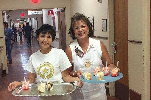 Lauren Braden (right) volunteering with the American Gold Star Moms for an ice cream sundae social at the Audie Murphy Veterans Affairs Hospital. Braden serves with the AGSM to honor her late son, Capt. Jeffery Braden. Courtesy photo