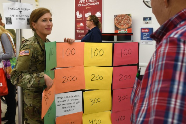 FORT DRUM, N.Y. -   Capt. Veronica Lazar, a physical therapist with Fort Drum's Connor Troop Medical Clinic and a native of Weston, Fla., plays a physical therapy question and answer game with an attendee of the annual Fort Drum Retiree Application Day at the Fort Drum Exchange Sept. 21.  Multiple healthcare representatives from the U.S. Army Medical Department Activity, Fort Drum, were in attendance at the event to provide retirees and their families with valuable health and wellness information.  (Photo by Warren W. Wright Jr., Fort Drum MEDDAC Public Affairs)