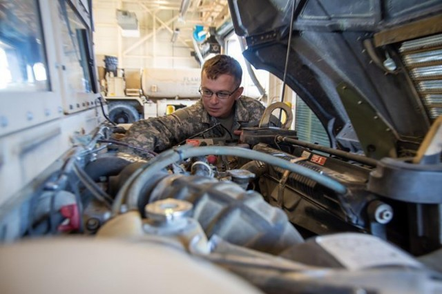 Sgt. Joseph Marx with B Troop, 3rd Cavalry Regimental Support Squadron checks vehicle fluids during a technical inspection. (U.S. Army photo by Sgt. Rene Rosas)