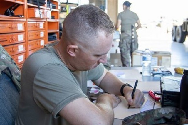 Sgt. Stephen Derr, lead technical inspector with B Troop, 3rd Cavalry Regimental Support Squadron works to complete paperwork. (U.S. Army photo by Sgt. Rene Rosas)