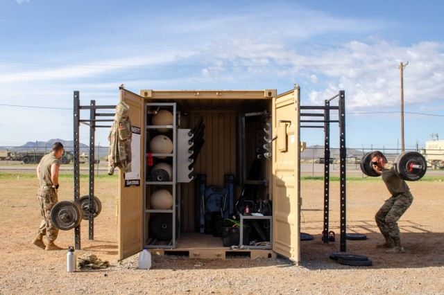 """Soldiers from the U.S. Army National Guard's 30th Armored Brigade Combat Team exercise with """"Gym-In-A-Box"""" equipment at Doña Ana Training Complex, Fort Bliss.  The 30th ABCT is currently mobilized here in preparation to support Operation Spartan Shield (Photo by Capt.  Joselyn Sydnor, 653rd Regional Support Group)."""