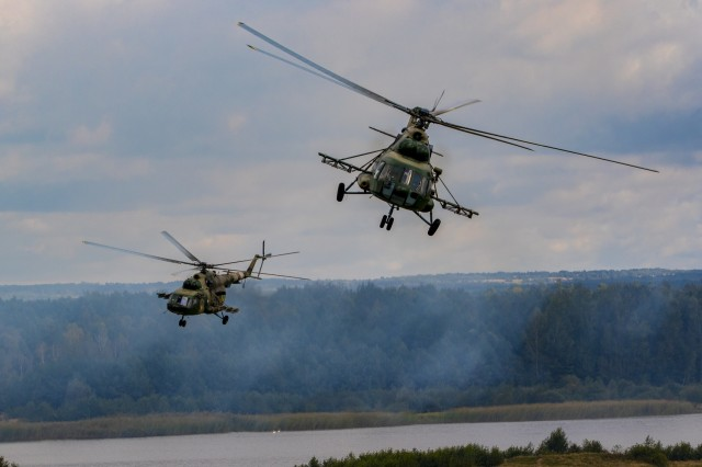 Ukrainian Helicopters provide aerial support during a wet gap crossing demonstration as part of Rapid Trident 2019, Sept. 20, 2019, near Yavoriv, Ukraine. RT19 is an annual, multinational exercise, which involves approximately 3,700 personnel from 14 nations, that support joint combined interoperability among partner militaries of Ukraine and the United States, as well as Partnership for Peace nations and NATO allies.