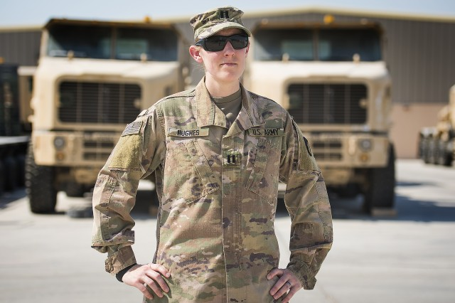 Capt. Ruth Hughes, support operations, 401st Army Field Support Battalion-Qatar, stands outside of an Army Prepositioned Stocks-5 warehouse where contractors had recently moved equipment to make room for facility improvements Sept. 15, Camp As Sayliyah, Qatar.