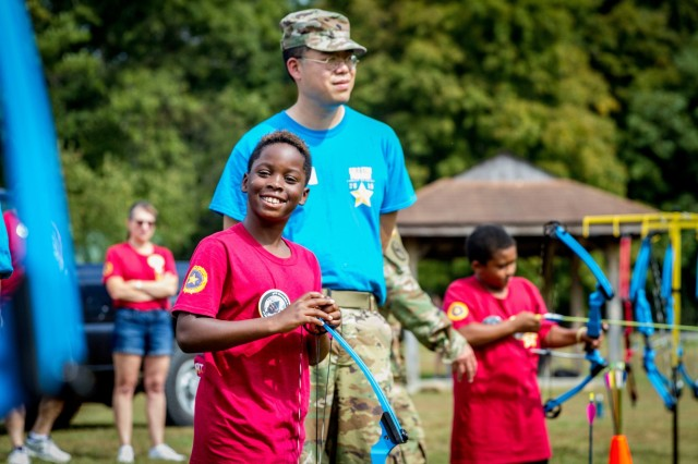 A West Virginia National Guard Solider watches as a participant of the Gold Star Families retreat takes part in an archery event Sept. 28, 2019, at Camp Dawson, W.Va. The Gold Star Families retreat is hosted each year by the WVNG to honor the service and sacrifice of Gold Star Families - those who have lost a family member in military service.