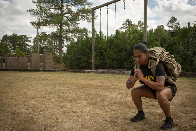 Sgt. 1st Class Elizabeth Calderon, Army Master Fitness Training instructor, performs modified squats Sept. 24, 2019, at the U.S. Army Physical Fitness School at Fort Jackson, S.C. As a training instructor, Calderon instructs and certifies the Army's master fitness trainers.