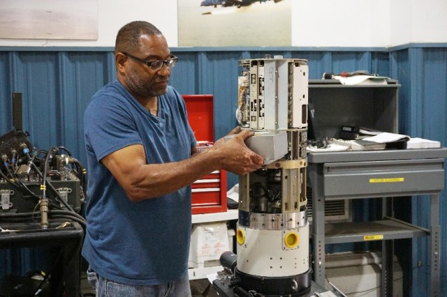 High-Speed Anti-Radiation Missile (HARM) technician works on a HARM