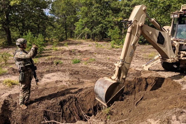 Spc. Austin Tome, supervises a High Mobility Engineer Excavator Type 1 creating an anti-tank ditch during the Mountain Peak exercise on Fort Drum, N.Y., Sept 12, 2019.  Tome is a Brogue, Pennsylvania native and is carrying on his family's Army legacy.