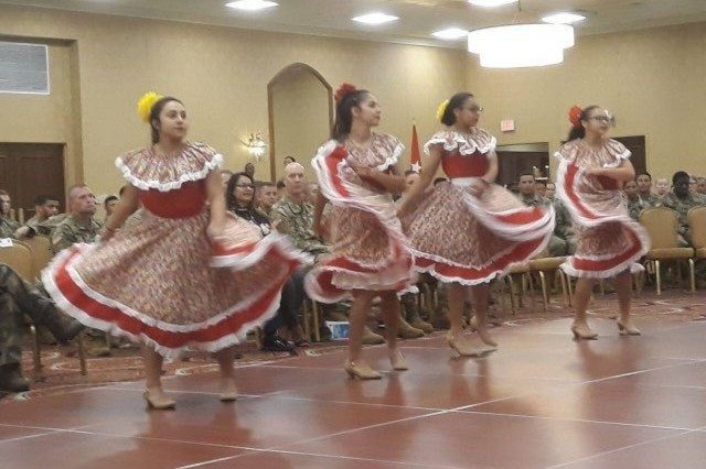 Yesenia Rafael, left, and Tania Rafael perform a Mexican traditional dance during the 3rd Infantry Division's annual celebration of National Hispanic Heritage Month of Service, hosted by the 2nd Armored Brigade Combat Team, held Sept. 25, 2019, at Club Stewart on Fort Stewart, Georgia. (Photo by Staff Sgt. Todd Pouliot, 50th Public Affairs Detachment)