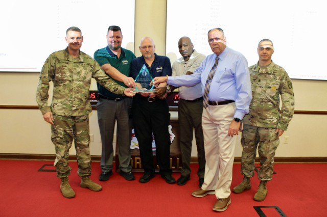 The Fires Center of Excellence and Fort Sill Safety Office was recognized as the 2018 Secretary of the Army/Chief of Staff of the Army Exceptional Organization Division/2-star Command winner. Maj. Gen. Wilson A. Shoffner, far left, FCoE and Fort Sill commanding general; and FCoE and Fort Sill Command Sgt. Maj. John Foley, far right, presented the award to Garry Gaede, FCoE deputy safety director; Kevin Enlow, safety specialist; Charles Brown, safety specialist; and John Cordes, FCoE safety director.
