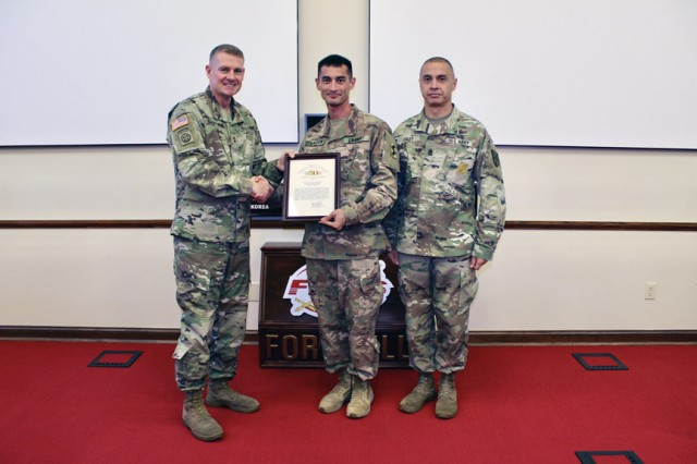 Maj. Gen. Wilson A. Shoffner, far left, Fires Center of Excellence and Fort Sill commanding general; and FCoE and Fort Sill Command Sgt. Maj. John Foley, present a TRADOC safety award to Maj. Raymond Stapleton, 95th Adjutant General Battalion (Reception), executive officer, Sept. 26, 2019, at McNair Hall.