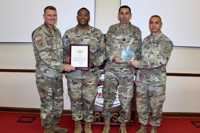 1st Battalion, 40th Field Artillery was recognized as the 2018 Secretary of the Army/Chief of Staff of the Army Exceptional Organization Battalion winner. Maj. Gen. Wilson A. Shoffner, far left, FCoE and Fort Sill commanding general; and FCoE and Fort Sill Command Sgt. Maj. John Foley, presented the award to 1-40th FA leaders 1st Lt. St. Joseph Hall, and Lt. Col. Grady Lowe, Sept. 26, 2019, at McNair Hall.