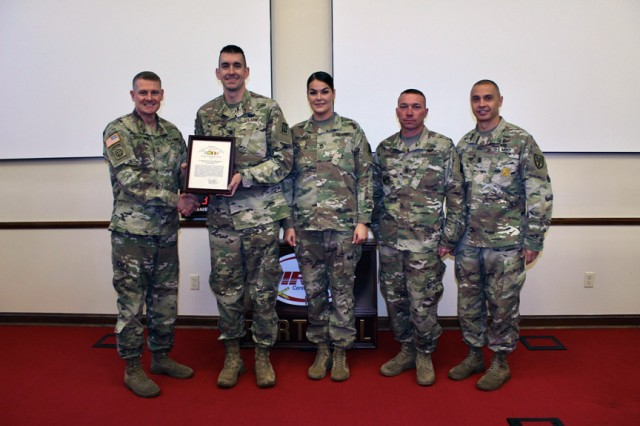 Maj. Gen. Wilson A. Shoffner, far left, Fires Center of Excellence and Fort Sill commanding general; and FCoE and Fort Sill Command Sgt. Maj. John Foley, present a TRADOC safety award to the 3rd Battalion, 6th Air Defense Artillery command team. It included Lt. Col. Joseph Scott, 3-6th ADA commander; Sgt. 1st Class Michelle Rodrigues, NCOIC; and Command Sgt. Maj. Aaron Drake. Rodrigues also received an individual safety award.