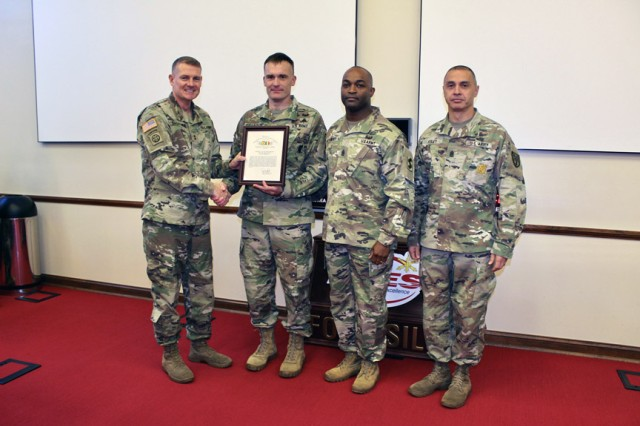Maj. Gen. Wilson A. Shoffner, far left, Fires Center of Excellence and Fort Sill commanding general; and FCoE and Fort Sill Command Sgt. Maj. John Foley, present a TRADOC safety award to the 1st Battalion, 31st Field Artillery command team: Lt. Col. Marcus Franzen, 1-31st FA commander; and Command Sgt. Maj. Mario Lindsey.