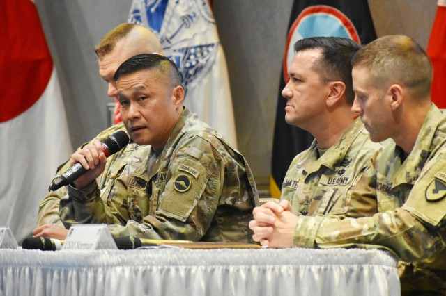Maj. Gen. Viet X. Luong, left, commander of U.S. Army Japan, speaks during the USARJ Housing Town Hall Meeting at the Camp Zama Community Club, Japan, Sept. 25.