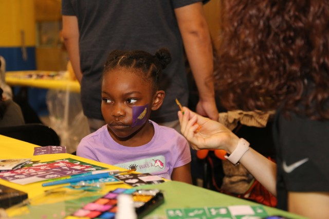Ariya Chism, 6, gets her face painted at the Day for Kids event held Sept. 21 at the Yano Fitness Center at Camp Zama, Japan. Camp Zama's Child and Youth Services hosted the event, which was organized in conjunction with the Boys and Girls Club of America. (U.S. Army photo by Noriko Kudo)