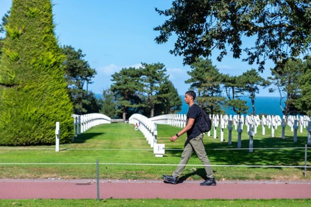 Spc. Kenneth Rutledge, assigned to Public Health Activity Rheinland-Pfalz, walking the grounds of the Normandy American Cemetery and Memorial in France.