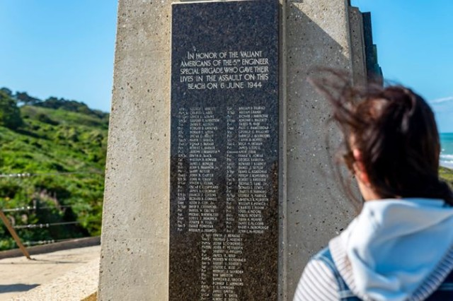 Staff Sgt. Ashlee Philips, assigned to Public Health Acitivity Rheinland-Pfalz, looking at the 5th Engineer Special Brigade memorial in Normandy, France.