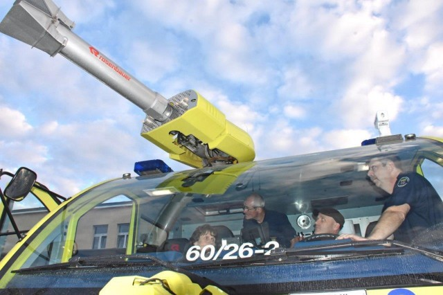 Volunteer firefighters Marita Montsch (from left), Peter Montsch and Sven Dietrich try out the controls of an aircraft rescue fire fighting truck under the supervision of U.S. Army Garrison Wiesbaden lead firefighter Bernd Link. All three were part of a delegation of 14 volunteer firefighters from the town of Obergladbach, about 30 kilometers from Clay Kaserne, visiting USAG Wiesbaden Sept 13, 2019.