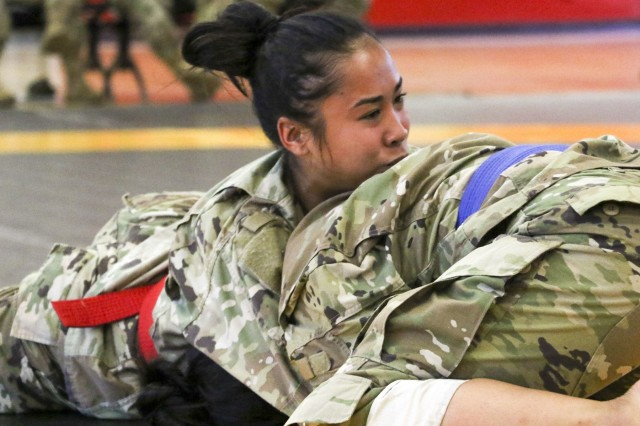 LANDSTUHL, Germany -- U.S. Army Spc. Fenny Descuatan attempts to perform a choke on her opponent during a combatives tournament held at Landstuhl Regional Medical Center, Sept. 27.