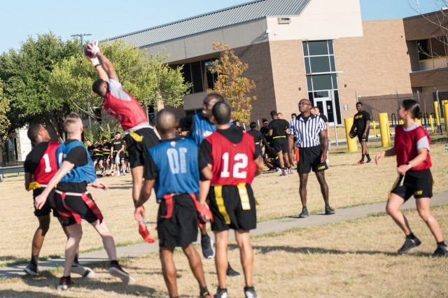 Sgt. Andrew Blowe, 49th Transportation Battalion, makes a highlight reel catch during the Commander's Cup flag football tournament Sept. 25.   After a grueling day of physical activities, 49th Transportation Battalion walked away as the 2019 Commander's Cup champions.  (U.S. Army photo by Sgt. 1st Class Kelvin Ringold)