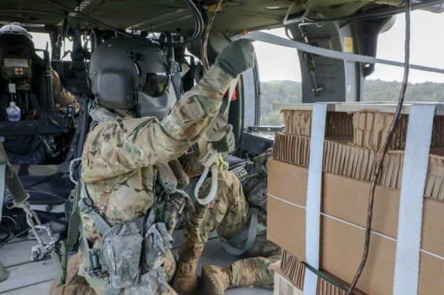 25th Combat Aviation Brigade Soldiers prepare to push out the aerial delivery using the free drop technique in support of four companies of the 2nd Battalion, 27th Infantry Regiment, 3rd Brigade Combat Team during Operation Lightning Strike field exercise. Each free drop supplied 2-27INF, 3IBCT Soldiers with 390lbs of meals and ammunition; approximately one day worth from four UH-60 Black Hawk helicopters to two locations simultaneously.