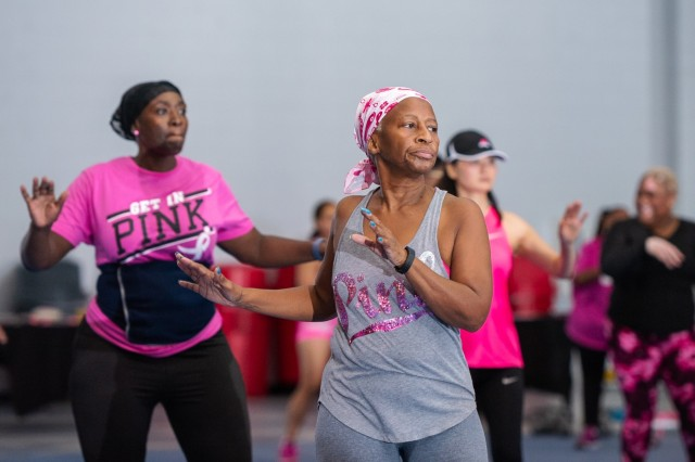 Ladies dressed in various shades of pink workout during the annual Do it in Pink aerobathon Sept. 21 at the Solomon Center. The annual event promotes breast cancer awareness and the importance of doing monthly self-breast exams to locate masses and lumps early for potential cancer treatment. By Earl Jones, Family MWR
