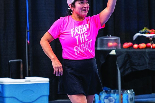An instructor  dressed in pink leads a workout during the annual Do it in Pink aerobathon Sept. 21 at the Solomon Center. The annual event promotes breast cancer awareness and the importance of doing monthly self-breast exams. Photo by Earl Jones, Family MWR