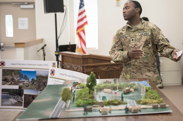 A petroleum specialist from 61st Quartermaster Battalion demonstrates the layout of a full Inland Pipeline Distribution System at the event.  Petroleum specialists from First Army Division West, 13th Expeditionary Sustainment Command, along with the Fort Hood Soldier for Life—Transition Assistance Program, hosted eight petroleum companies from Houston and San Antonio, Texas and other partner cities of Fort Hood June 21, 2019. (Photo by Sgt. 1st Class Kelvin Ringold)