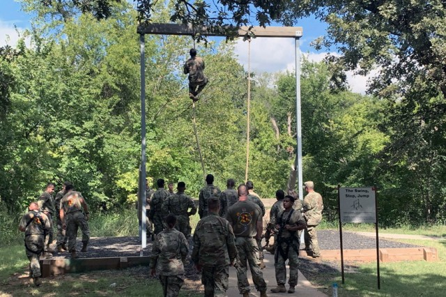 A Cameron University Army ROTC cadet climbs a rope obstacle at the Combat Confidence Course Sept. 19, 2019, at Fort Sill, Okla. 1st Battalion, 79th Field Artillery partnered with CU to help prepare the cadets for their Ranger Challenge.