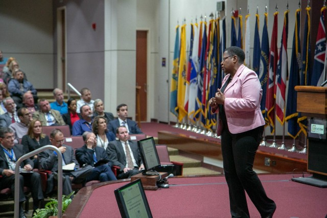 """Dr. Juanita Christensen, U.S. Army Combat Capabilities Development Command Aviation & Missile Center executive director, provides an update to the workforce during a town hall Sept. 30. In addition to briefing the workforce on the latest in products, partnerships and processes, she recognized employees for a variety of achievements, stating, """"This is always a great moment for me because it allows me a chance to award and recognize our people, and the work that we do here at our center."""""""