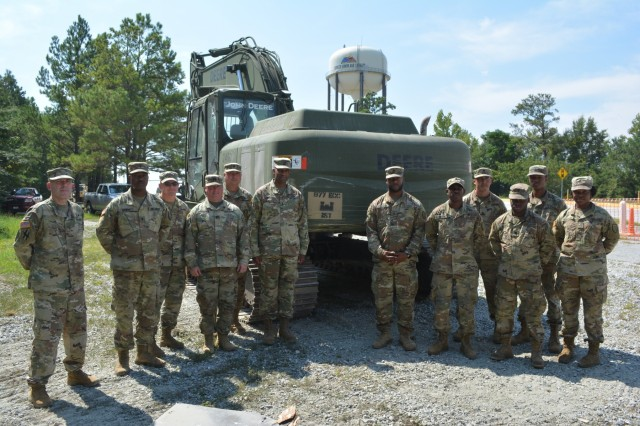 FORT BENNING, Ga. -- Maj. Gen. Gary M. Brito, center left, Maneuver Center of Excellence and Fort Benning commanding general, poses with Soldiers of the 877th Engineer Company, 878th Engineer Battalion, Georgia Army National Guard, Sept. 13. U.S. Army Garrison Fort Benning and the Georgia Army National Guard worked together for two weeks to demolish dilapidated buildings and to provide the National Guard Soldiers mission-essential task training recently. (U.S. Army photo by Bryan Gatchell, Maneuver Center of Excellence, Fort Benning Public Affairs)
