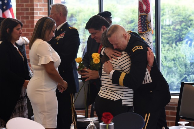 Lt. Gen. Thomas S. James Jr., Commanding General, First U.S. Army, hugs a Gold Star Mother after she received a yellow rose during the Gold Star Mother's Day luncheon, September 29, 2019, at Cantigny Park in Wheaton, Illinois. The United States first began observing Gold Star Mother's Day on the last Sunday of September in 1936. James, Illinois Governor J.B. Pritzker, and a dozen dignitaries attended the Gold Star Mother's Day luncheon. The luncheon honored the sacrifice of Gold Star Mothers and Families who have lost a loved one while serving in the U.S. military. An estimated 150 Gold Star Mothers and supporters attended the luncheon. Pritzker officially proclaimed September 29, 2019 as Gold Star Mother's Day in Illinois. Members of the Illinois Patriot Guard lined the walkway to the entrance of the LeJardin Room where the event was held. (U.S. Army Reserve photo by Sgt. David Lietz)