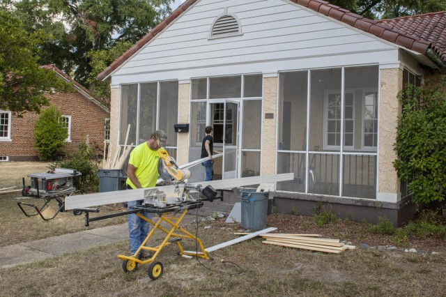 FORT BENNING, Ga. -- Workers installing new windows at one of Fort Benning's many historic homes Oct. 1, part of a broader effort underway since about a year ago to curb lead-based paint hazards in the historic homes, those built before a 1978 federal law that bans use of lead-based paint. Replacing windows with exposed lead is only one part of Fort Benning's overall effort at lead-based paint remediation and improvement of overall housing service. It also includes extensive renovation to many of the historic homes. In addition, officials have in the past year introduced stringent new repair and inspection practices and hired more housing staff, and senior leadership is keeping strong emphasis on making housing service efficient, transparent and responsive to residents. (U.S. Army photo by Patrick A. Albright, Maneuver Center of Excellence, Fort Benning Public Affairs)