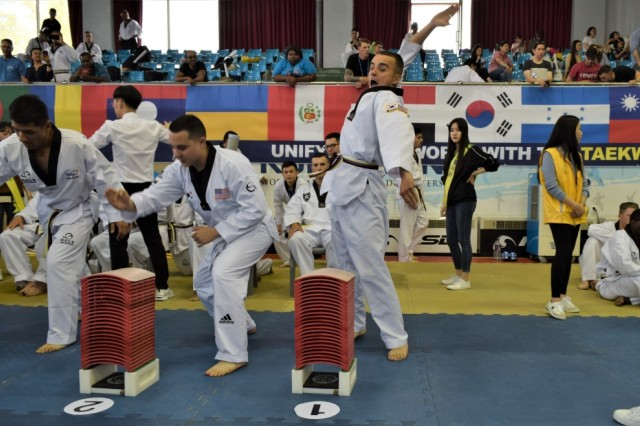 Spc. Omead Saney prepares to strike some boards at the 2019 Foreigners Taekwondo Culture Festival at Kukkiwon Taekwondo Headquarters in Gangnam, Seoul, South Korea, Sept. 28. Saney helped represent 2nd Infantry Division/Republic of Korea-U.S. Combined Division.