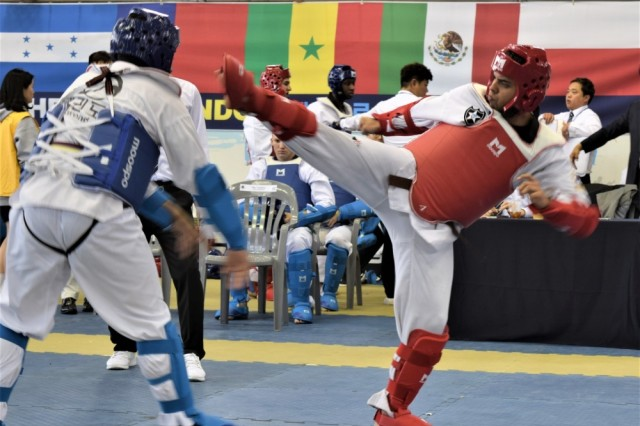 Spc. Alex Tejera Medina, 401st Military Police Company (right), spars with an opponent during the 2019 Foreigners Taekwondo Culture Festival at Kukkiwon Taekwondo Headquarters in Gangnam, Seoul, South Korea, Sept. 28.