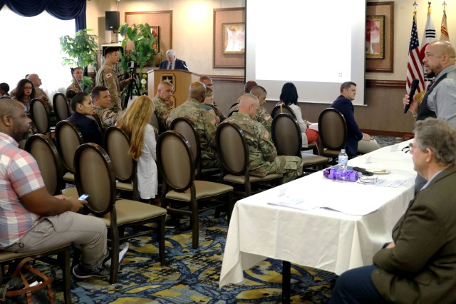 Eliot Bradley, USAG Daegu director of Emergency Services, answers a question from the audience during the Community Information Gathering held on Camp Walker Sept. 30.