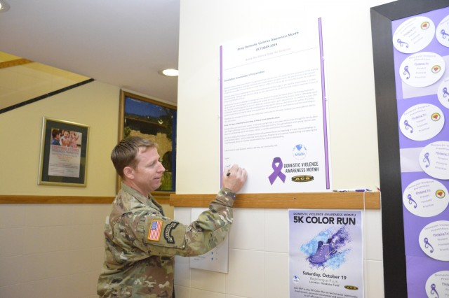 USAG Italy Garrison Commander Col. Daniel J. Vogel signs a proclamation designating October as Domestic Awareness Month.  During the month, the USAG Italy community is encourage to learn more about domestic violence and be ready to help those who are silent about abuse.